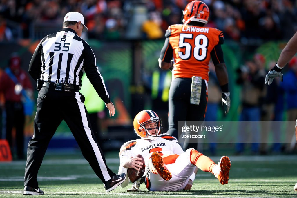 Cody Kessler #6 of the Cleveland Browns reacts after being sacked by Carl Lawson #58 of the Cincinnati Bengals in the first half of a game at Paul Brown Stadium on November 26, 2017 in Cincinnati, Ohio. The Bengals won 30-16.
