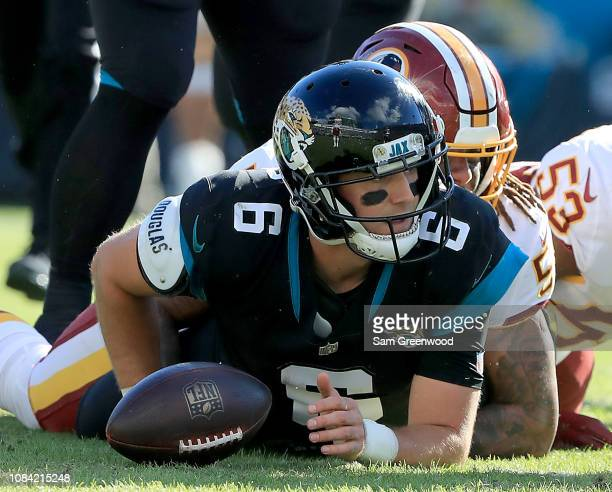 Cody Kessler of the Jacksonville Jaguars is sacked by Jonathan Allen of the Washington Redskins during the game at TIAA Bank Field on December 16...
