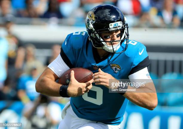 Cody Kessler of the Jacksonville Jaguars scrambles for yardage during the game against the Houston Texans at TIAA Bank Field on October 21 2018 in...