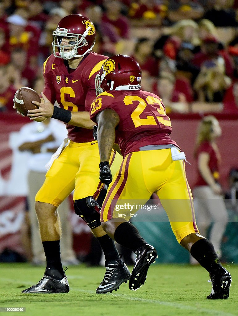 Cody Kessler #6 of the USC Trojans hands off to Tre Madden #23 of the USC Trojans against the Arkansas State Red Wolves at Los Angeles Coliseum on September 5, 2015 in Los Angeles, California.