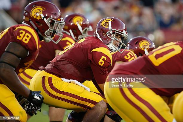 Cody Kessler of the USC Trojans takes a snap during the first half of a game against the Washington Huskies at Los Angeles Memorial Coliseum on...