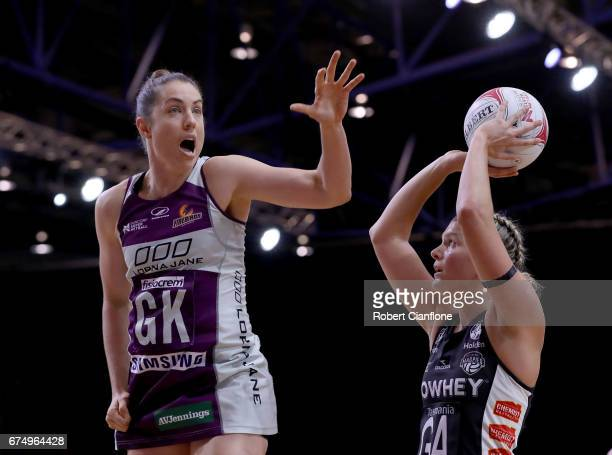 Cody Lange of the Magpies is preesured by Laura Clemesha of the Firebirds during the round 10 Super Netball match between the Magpies and the...