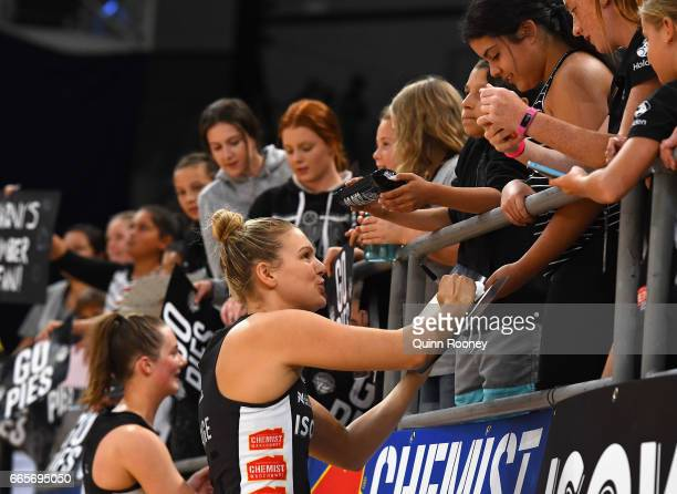 Cody Lange of the Magpies signs autographs during the round eight Super Netball match between the Magpies and Fever at Hisense Arena on April 7 2017...