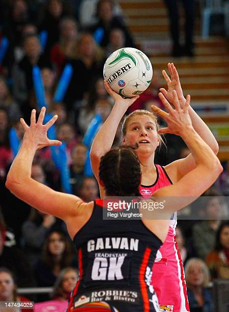 Cody Lange of Thunderbirds tries to score past Anna Galvan of Tactix during the round 14 ANZ Championship match between the Thunderbirds and the...