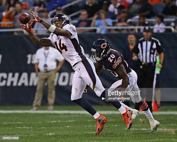 Cody Latimer of the Denver Broncos catches a pass in front of DeVante Bausby of the Chicago Bears at Soldier Field on August 11 2016 in Chicago...