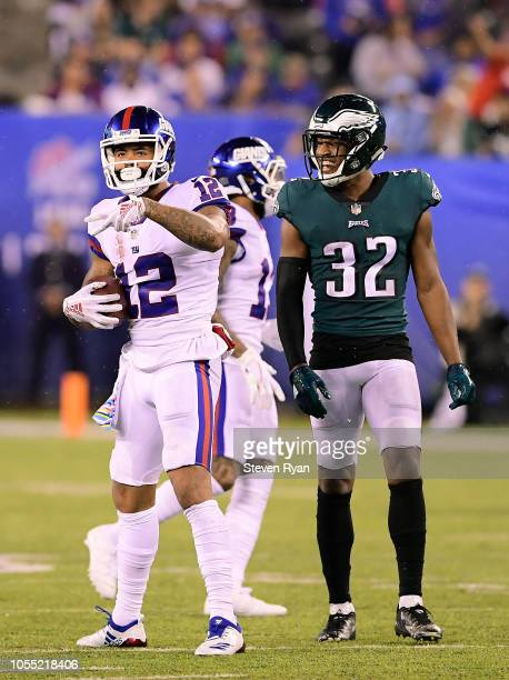 Cody Latimer of the New York Giants and Rasul Douglas of the Philadelphia Eagles react at MetLife Stadium on October 11 2018 in East Rutherford New...
