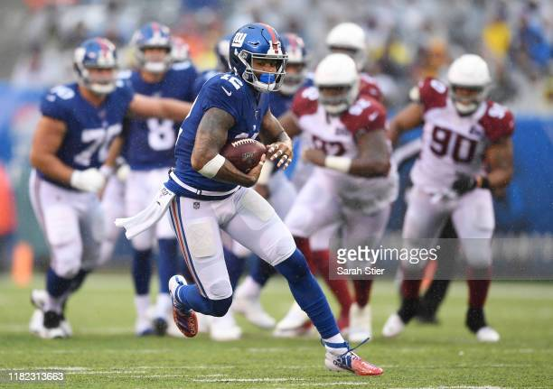 Cody Latimer of the New York Giants carries the ball during the fourth quarter of the game against the Arizona Cardinals at MetLife Stadium on...