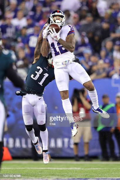 Cody Latimer of the New York Giants catches a pass against Jalen Mills of the Philadelphia Eagles during the second quarter at MetLife Stadium on...