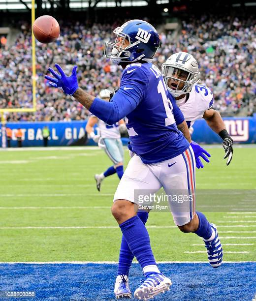 Cody Latimer of the New York Giants makes a second quarter touchdown reception while defended by Byron Jones of the Dallas Cowboys at MetLife Stadium...