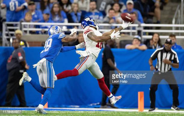Cody Latimer of the New York Giants makes the touchdown catch as Rashaan Melvin of the Detroit Lions defends during the fourth quarter of the game at...