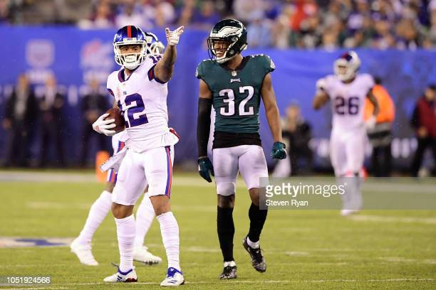 Cody Latimer of the New York Giants reacts after making a catch against Michael Thomas of the New York Giants during the second quarter at MetLife...