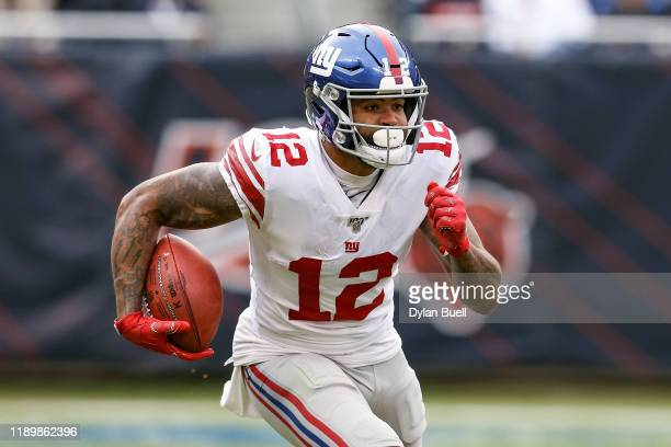 Cody Latimer of the New York Giants runs with the ball in the third quarter against the Chicago Bears at Soldier Field on November 24 2019 in Chicago...