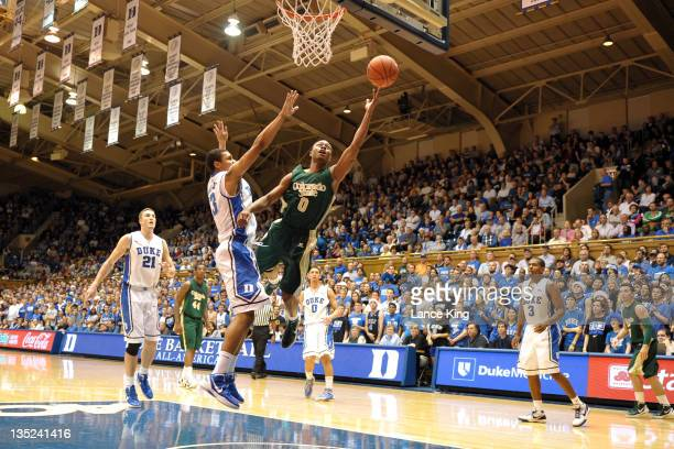 Cody Mann of the Colorado State Rams goes to the hoop against Michael Gbinije of the Duke Blue Devils at Cameron Indoor Stadium on December 7 2011 in...
