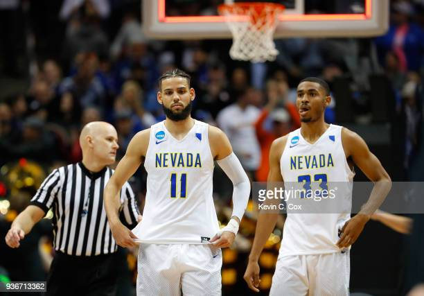 Cody Martin and Josh Hall of the Nevada Wolf Pack look on after being defeated by the Loyola Ramblers during the 2018 NCAA Men's Basketball...