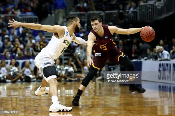Cody Martin of the Nevada Wolf Pack defends Clayton Custer of the Loyola Ramblers in the second half during the 2018 NCAA Men's Basketball Tournament...