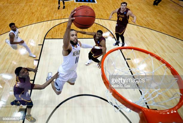 Cody Martin of the Nevada Wolf Pack goes up for a dunk in the first half against the Loyola Ramblers during the 2018 NCAA Men's Basketball Tournament...