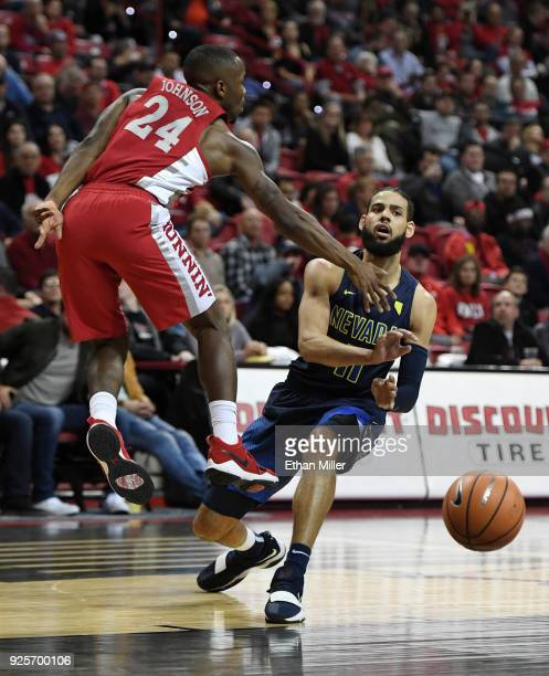 Cody Martin of the Nevada Wolf Pack passes against Jordan Johnson of the UNLV Rebels during their game at the Thomas Mack Center on February 28 2018...