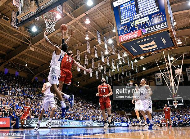 Cody Martin of the North Carolina State Wolfpack drives against Brandon Ingram of the Duke Blue Devils during their game at Cameron Indoor Stadium on...