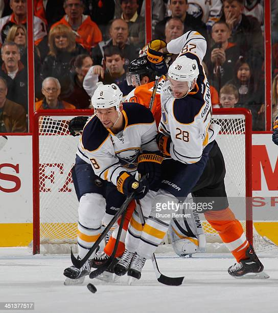 Cody McCormick and Zemgus Girgensons of the Buffalo Sabres skate against the Philadelphia Flyers at the Wells Fargo Center on November 21 2013 in...
