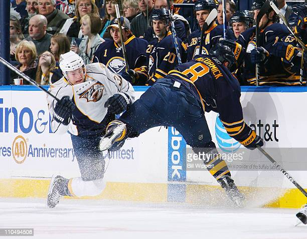 Cody McCormick of the Buffalo Sabres and Colin Wilson of the Nashville Predators collide into the boards at HSBC Arena on March 20 2011 in Buffalo...
