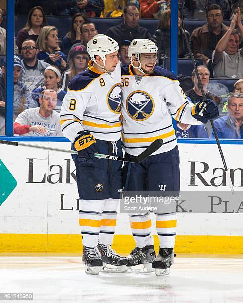 Cody McCormick of the Buffalo Sabres celebrates his goal with teammate Patrick Kaleta during the second period against the Tampa Bay Lightning at the...