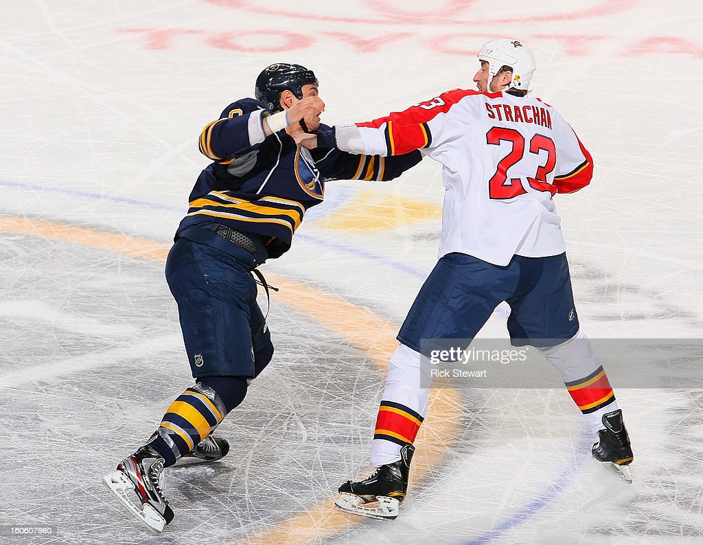 Cody McCormick #8 of the Buffalo Sabres fights with Tyson Strachan #23 of the Florida Panthers in the first period at First Niagara Center on February 3, 2013 in Buffalo, New York.