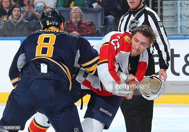 Cody McCormick of the Buffalo Sabres knocks the helmet of Tyson Strachan of the Florida Panthers off with a punch on February 3 2013 at the First...