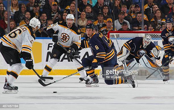 Cody McCormick of the Buffalo Sabres looks to block a shot from David Krejci of the Boston Bruins on October 18 2014 at the First Niagara Center in...