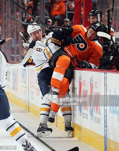 Cody McCormick of the Buffalo Sabres puts Jay Rosehill of the Philadelphia Flyers into the Flyers bench during the second period at the Wells Fargo...