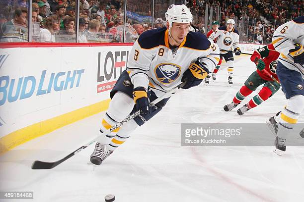 Cody McCormick of the Buffalo Sabres skates with the puck against the Minnesota Wild during the game on November 13 2014 at the Xcel Energy Center in...