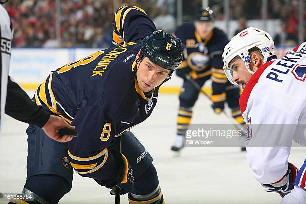 Cody McCormick of the Buffalo Sabres takes a faceoff against Tomas Plekanec of the Montreal Canadiens on February 7 2013 at the First Niagara Center...