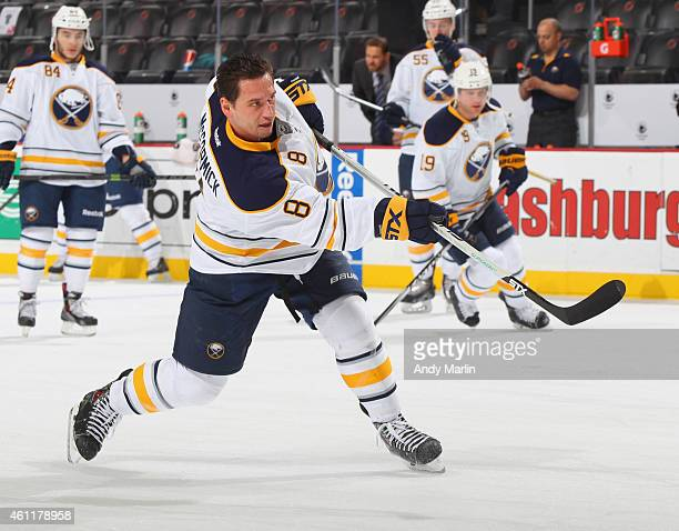 Cody McCormick of the Buffalo Sabres takes a shot during pregame warmups prior to the game against the New Jersey Devils at the Prudential Center on...