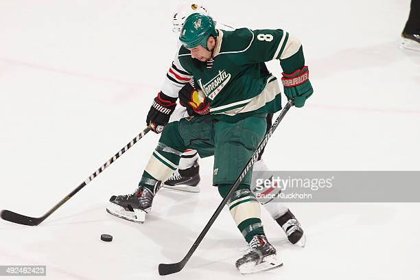Cody McCormick of the Minnesota Wild and Duncan Keith of the Chicago Blackhawks battle for the puck during Game Six of the Second Round of the 2014...