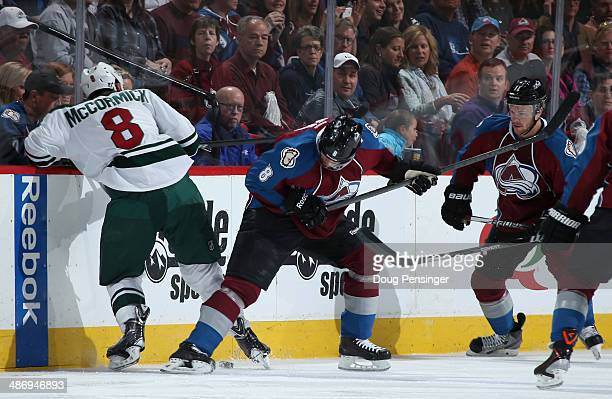 Cody McCormick of the Minnesota Wild and Jan Hejda of the Colorado Avalanche battle for control of the puck in Game Five of the First Round of the...
