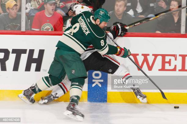 Cody McCormick of the Minnesota Wild checks Nick Leddy of the Chicago Blackhawks during Game Six of the Second Round of the 2014 Stanley Cup Playoffs...