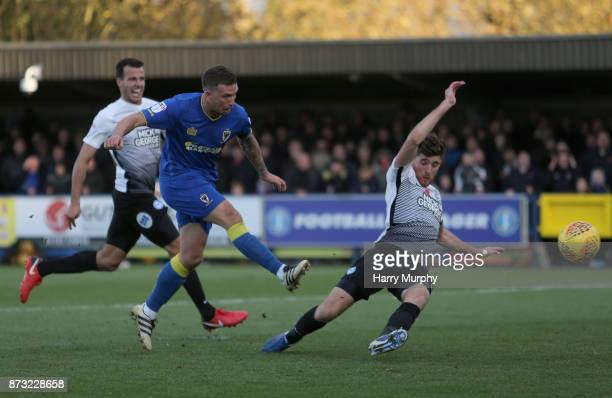 Cody McDonald of A.F.C. Wimbledon scores his sides second goal during the Sky Bet League One match between A.F.C. Wimbledon and Peterborough United...