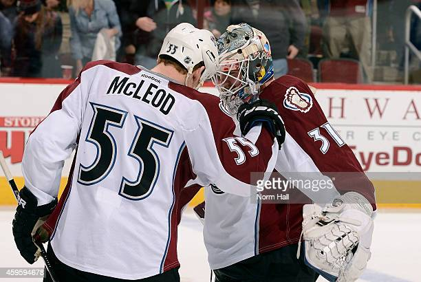 Cody McLeod and goaltender Calvin Pickard of the Colorado Avalanche celebrate a 4-3 overtime victory over the Arizona Coyotes at Gila River Arena on...