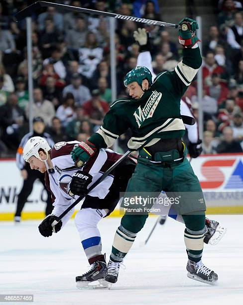 Cody McLeod of the Colorado Avalanche and Cody McCormick of the Minnesota Wild get tangled up during the first period in Game Four of the First Round...