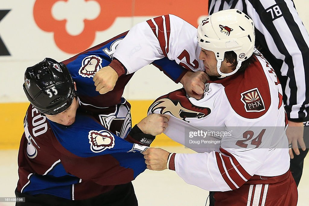Cody McLeod #55 of the Colorado Avalanche and Kyle Chipchura #24 of the Phoenix Coyotes are penalized for fighting in the first period at the Pepsi Center on February 11, 2013 in Denver, Colorado.