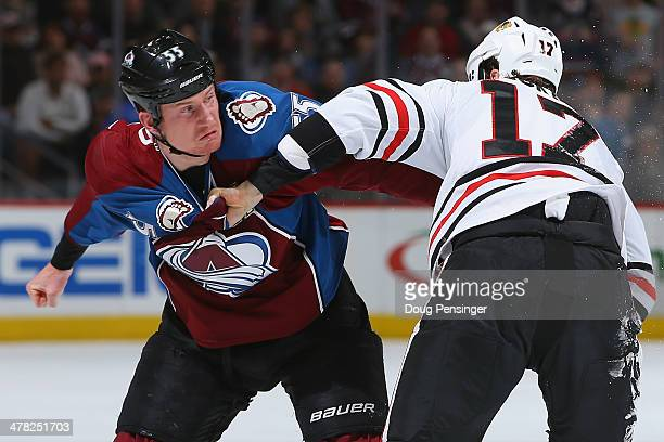 Cody McLeod of the Colorado Avalanche and Sheldon Brookbank of the Chicago Blackhawks engage in a fight and draw penalties in the first period at...