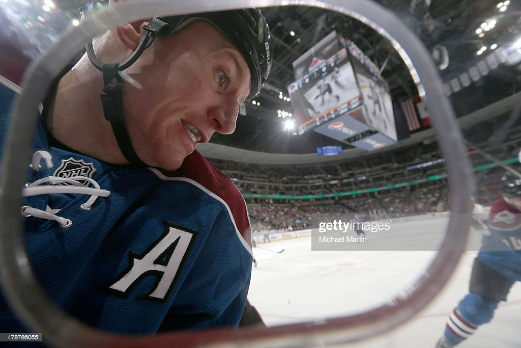Cody McLeod #55 of the Colorado Avalanche fights for the puck against the Anaheim Ducks at the Pepsi Center on March 14, 2014 in Denver, Colorado.