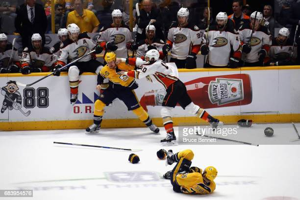 Cody McLeod of the Nashville Predators and Jared Boll of the Anaheim Ducks fight during the second period in Game Three of the Western Conference...