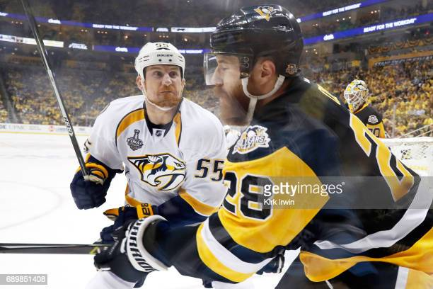 Cody McLeod of the Nashville Predators body checks Ian Cole of the Pittsburgh Penguins during the first period in Game One of the 2017 NHL Stanley...