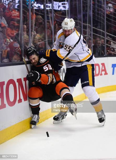 Cody McLeod of the Nashville Predators checks Shea Theodore of the Anaheim Ducks into the end boards during the second period of Game One of the...