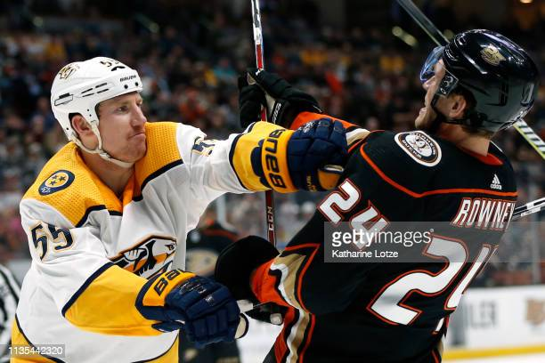 Cody McLeod of the Nashville Predators throws a punch at Carter Rowney of the Anaheim Ducks during the second period at Honda Center on March 12 2019...