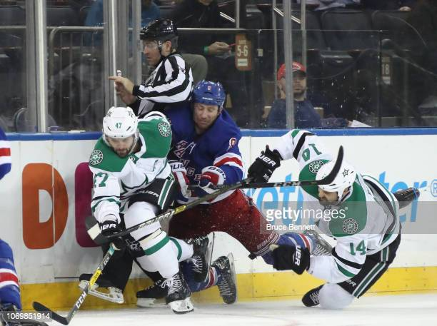 Cody McLeod of the New York Rangers runs into Alexander Radulov and Jamie Benn of the Dallas Stars during the third period at Madison Square Garden...