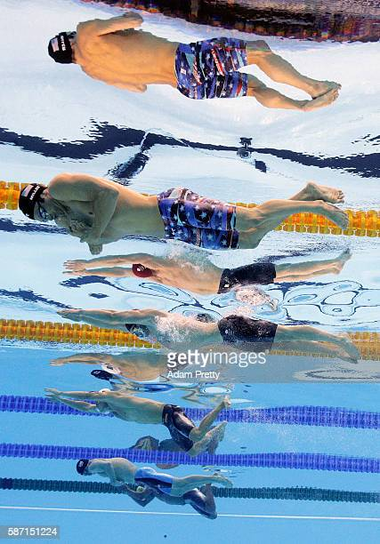 Cody Miller of the United States Adam Peaty of Great Britain and Cameron van der Burgh of South Africa compete in the Men's 100m Breaststroke Final...