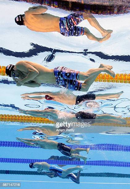 Cody Miller of the United States, Adam Peaty of Great Britain, Cameron van der Burgh of South Africa and Kevin Cordes of the United States compete in...