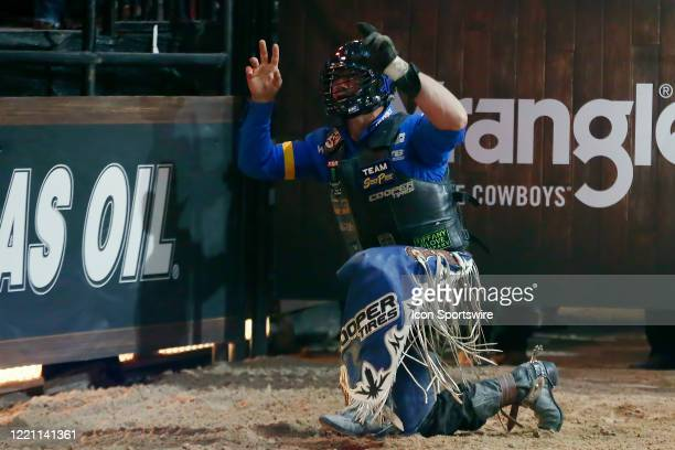 Cody Nance kneels following his ride of bull Marquis Metal Works Draggin Up during the Monster Energy Team Challenge on June 19 2020 at the South...