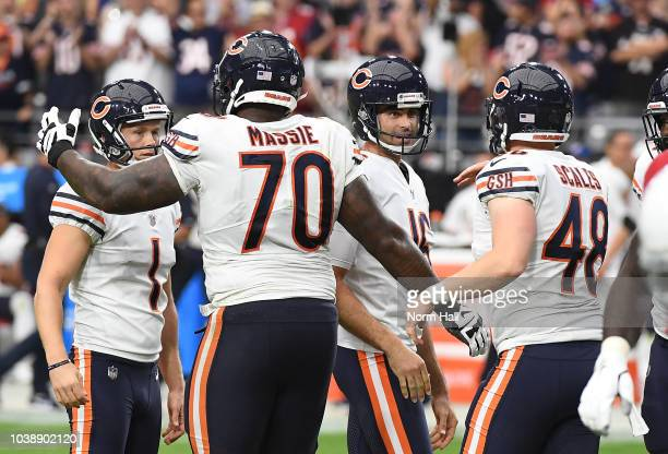 Cody Parkey Bobby Massie Pat O'Donnell and Patrick Scales of the Chicago Bears celebrate the go ahead field goal against the Arizona Cardinals at...